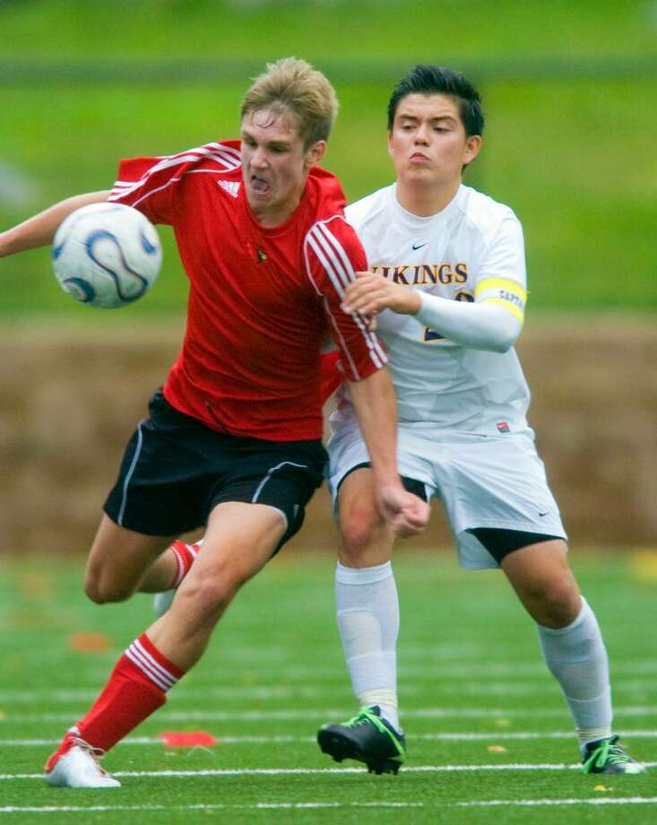 Gregory Kane, left, of Greenwich High School, and Henry Bareiss, right, of Westhill High School, during an FCIAC soccer match at Westhill High School in Stamford on Tuesday, Sept. 29, 2009. Photo: Chris Preovolos / Stamford Advocate