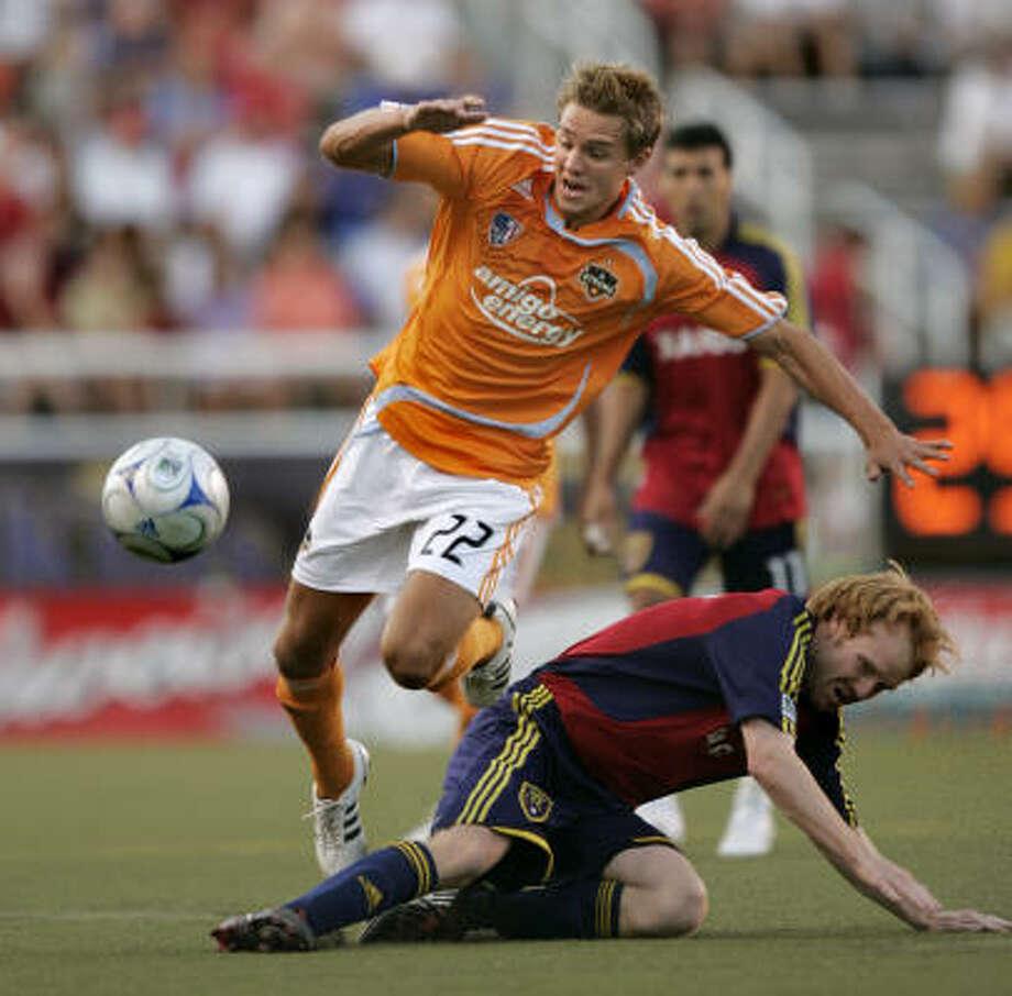 Dynamo midfielder Stuart Holden (22) passes Real Salt Lake midfielder Kenny Cutler during the first half. Photo: Douglas C. Pizac, AP