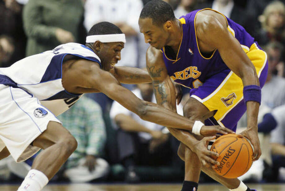 Guard Josh Howard, left, and the Mavericks got the best of Kobe Bryant and the Lakers on Wednesday. Photo: Matt Slocum, AP