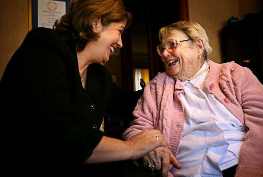 Mahnaz Pourian, left, owner of Home Instead Senior Care in the Medical Center area, visits one of her clients, 101-year-old Lulu Ricker, at Ricker's home. Photo: ERIN TRIEB, FOR THE CHRONICLE