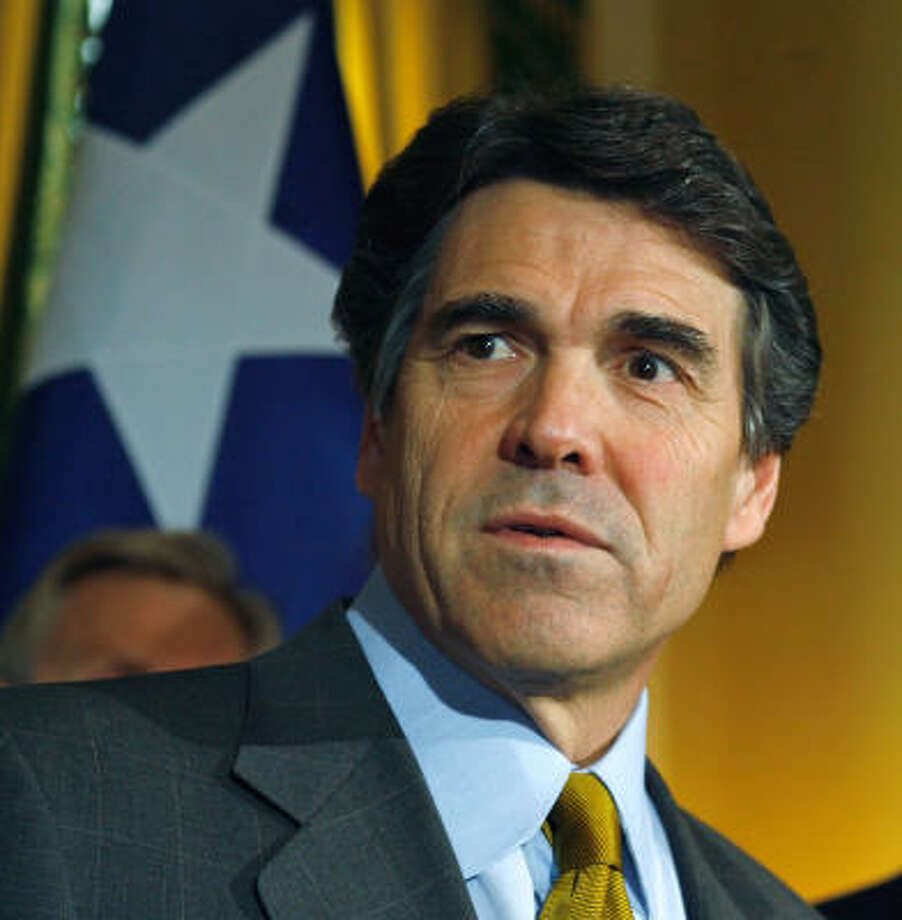 Gov. Rick Perry's profile has been raised by the decision to require administration of the human papillomavirus vaccine. Photo: Harry Cabluck, AP
