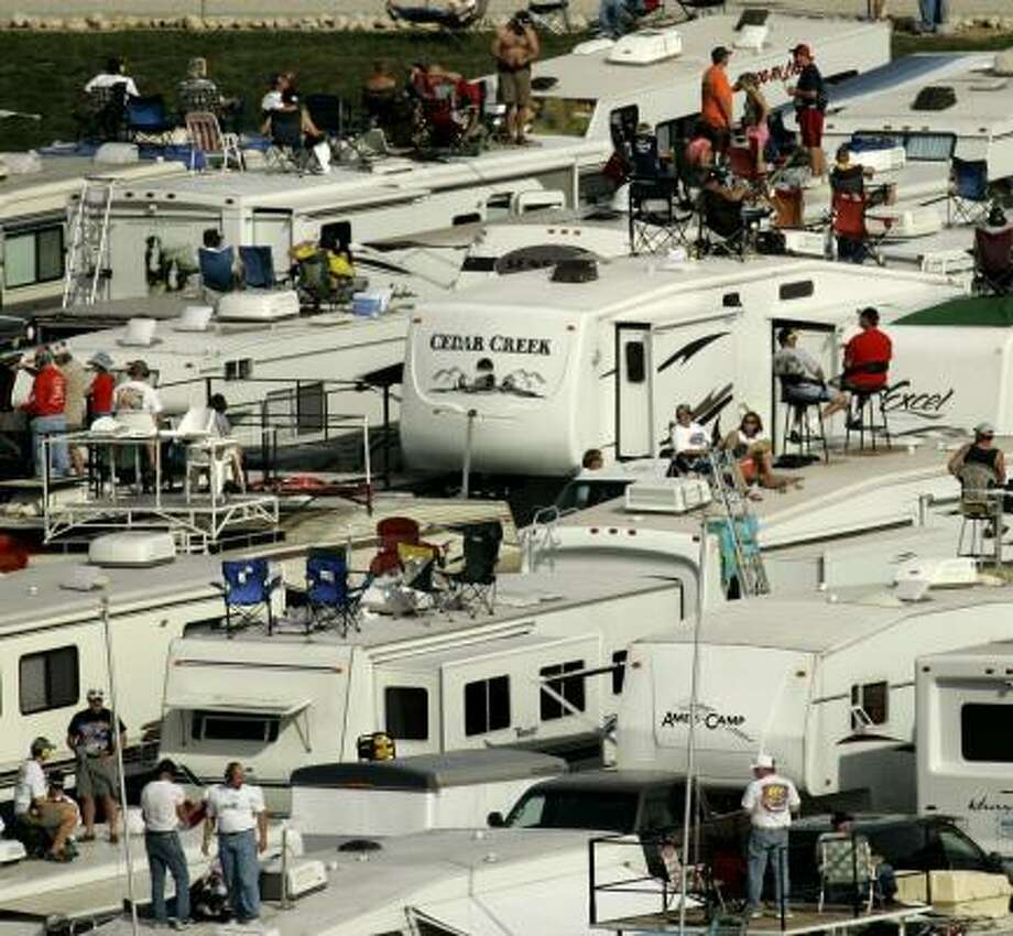 Recreational vehicles are common at NASCAR races, but rising gas prices are keeping many fans away from the track. Photo: JAE C. HONG, AP