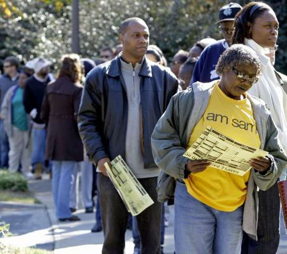 Voters in Charlotte, N.C., stand in line at an early voting site Thursday morning. Photo: CHUCK BURTON, ASSOCIATED PRESS