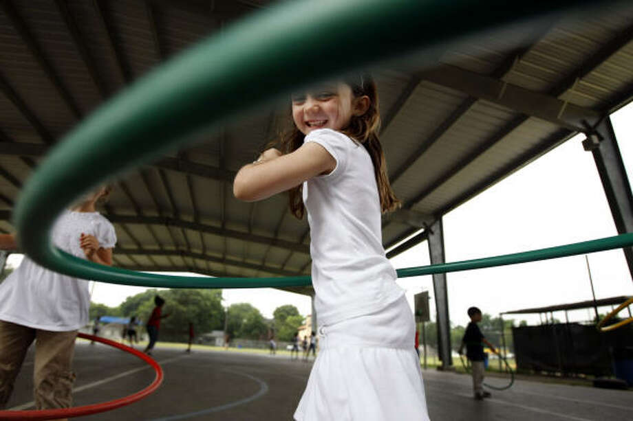 Paul W. Horn Academy kindergartner Grace Beasley has big Hula-Hooping plans for her summer vacation. Photo: Kevin Fujii, Chronicle
