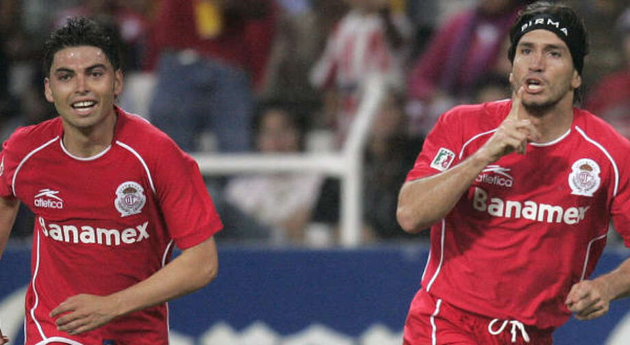 Toluca's Bruno Marioni, right, and Vicente Sanchez play for one of Mexico's most consistent teams. Photo: GUILLERMO ARIAS, AP
