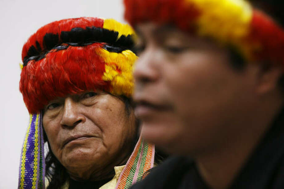 Peruvian Achuar leaders Marcial Huaman, left, and Gonzalo Payma Carijano were in town last week to ask ConocoPhillips not to drill for oil in their areas. Photo: Kevin Fujii, Chronicle