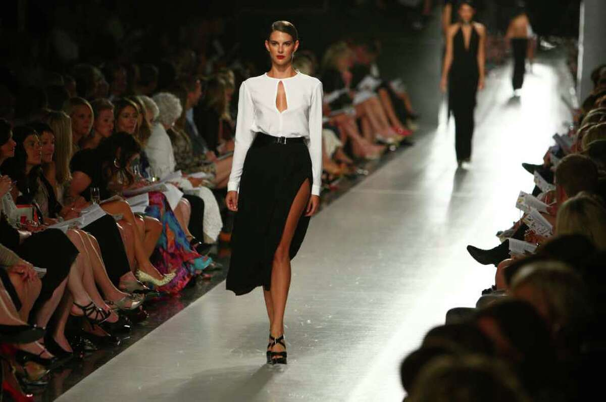 A model wears a Michael Kors design on the runway during the Nordstrom Designer Preview fall fashion show.