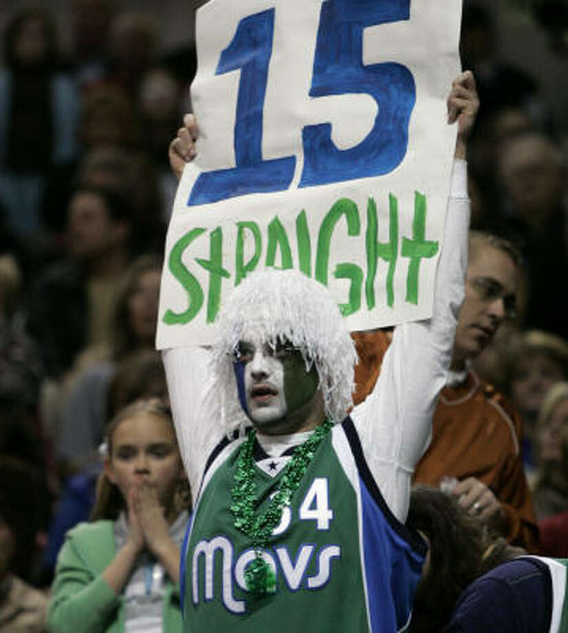 Saturday's win brought a team-record streak to the Mavericks and their fans. Photo: Tony Gutierrez, AP