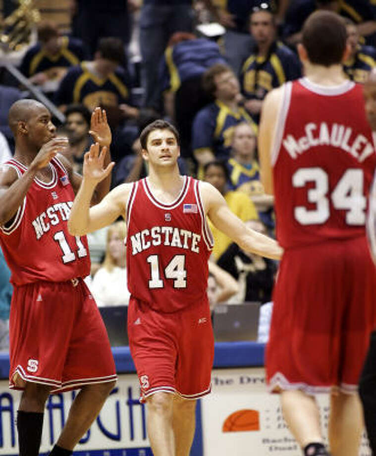 North Carolina State's Gavin Grant (11) and Engin Atsur walk toward teammate Ben McCauley (34) as they begin to celebrate their win over Drexel. Photo: Tom Mihalek, AP