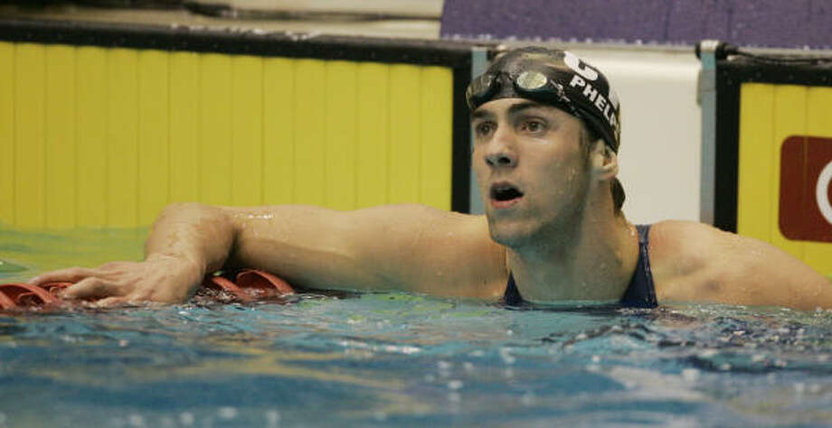 Michael Phelps looks up as his winning time of 51.39 seconds -- which broke his long-course record -- in the 100-meter butterfly is posted at the U.S. Swimming Nationals in Indianapolis. Photo: DARRON CUMMINGS, AP