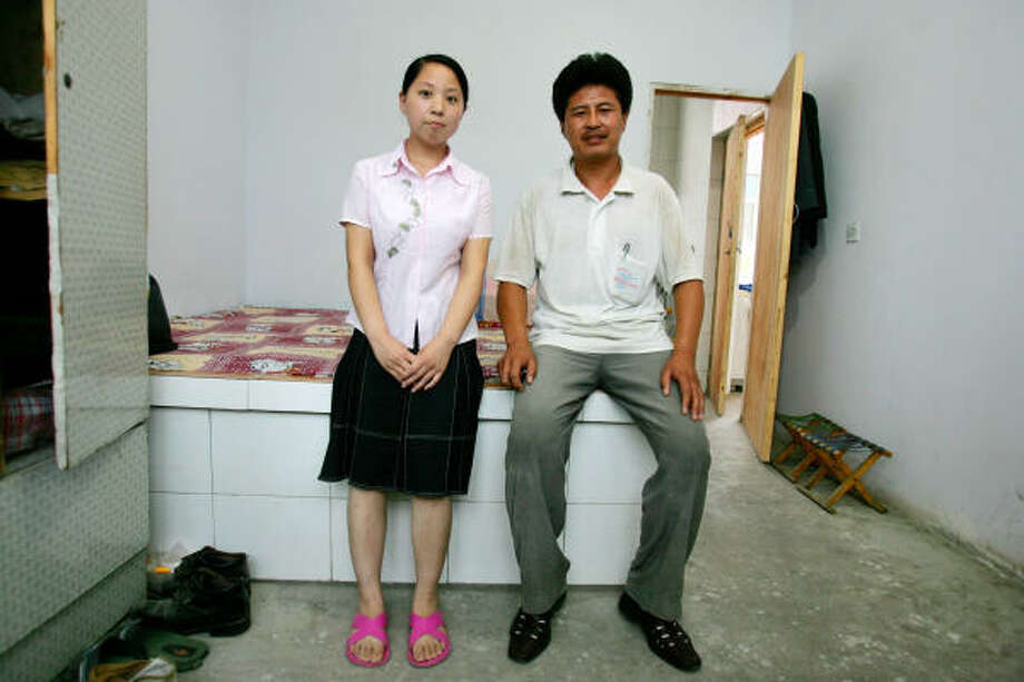 Yang Zhongchen and his wife, Jin Yani, live in a one-bedroom home in Qianan, China. Seven years ago, she was dragged to a clinic, where her baby was killed by injection while still inside her. Photo: Elizabeth Dalziel, AP