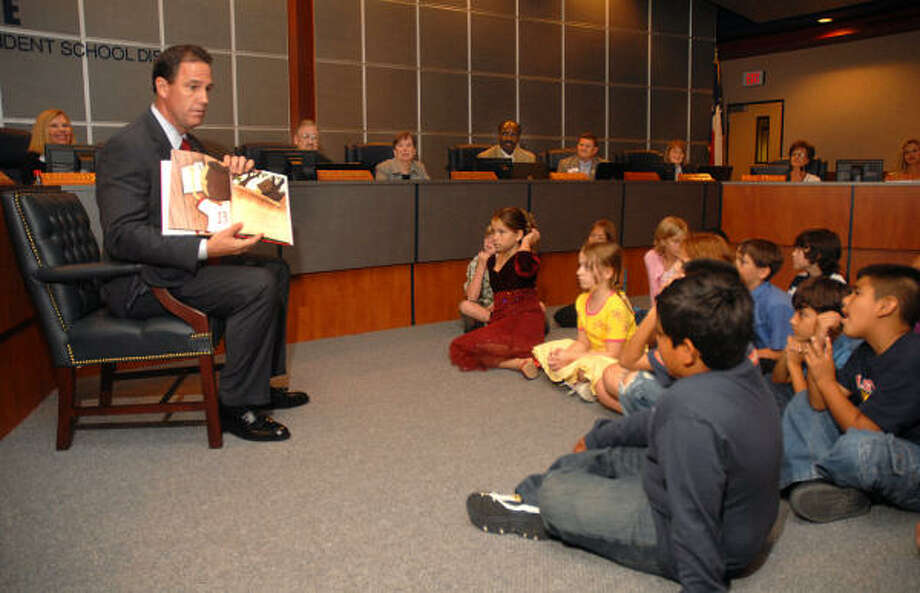 Conroe ISD Superintendent Don Stockton reads to Armstrong Elementary fourth-graders as part of his reading initiative during the CISD board meeting Tuesday. Photo: David Hopper, For The Chronicle
