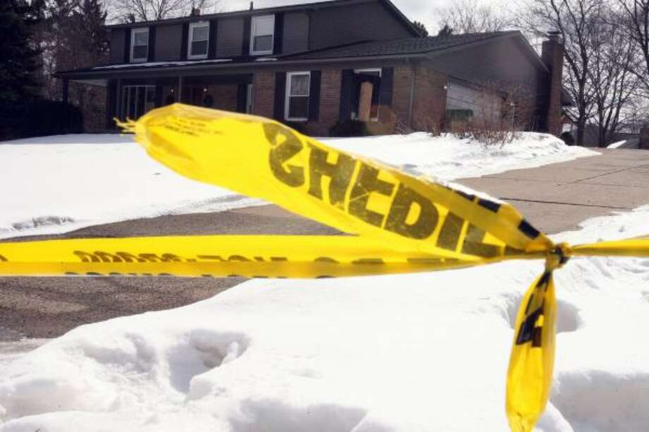 Police tape blocks off the home Stephen Grant shared with his wife, Tara. Grant is a suspect in her death and dismemberment. Photo: KATHLEEN GALLIGAN, DETROIT FREE PRESS