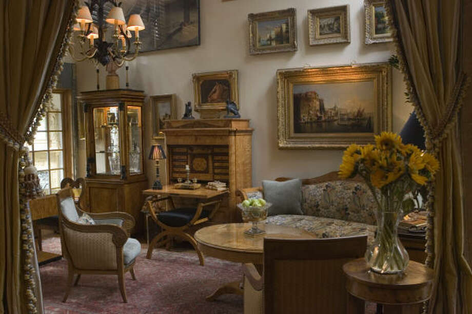 Although it houses an important collection of Biedermeier furniture - including a seating area with two period Charles X bergeres, a sofa, chest and oval table - Gosselin's living room is warm and welcoming. It also holds his first Biedermeier purchase: an Austrian fall-front secretary. Photo: Mayra Beltran, Chronicle