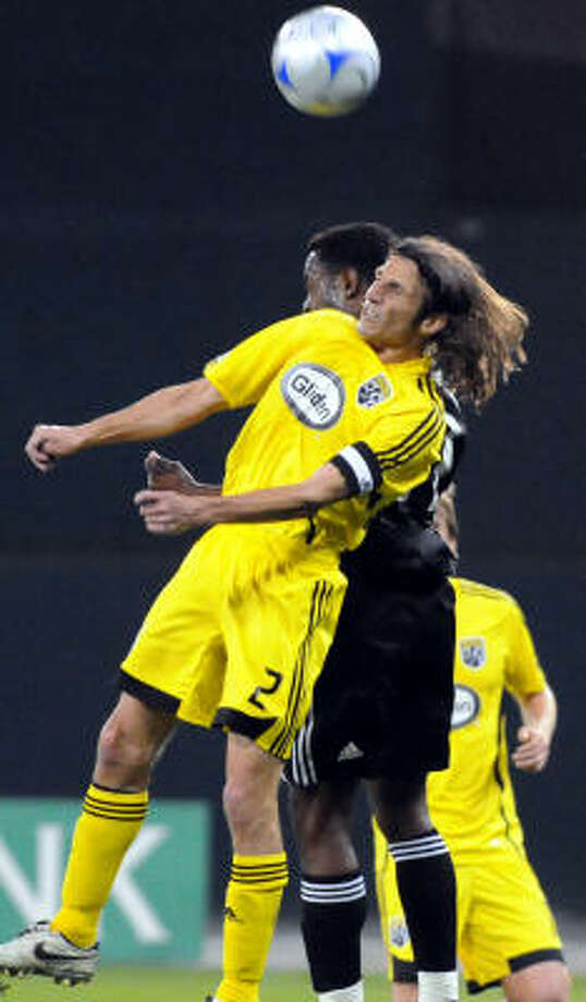 Columbus Crew defender Frankie Hejduk (2) and D.C. United forward Luciano Emilio battle for a header ball during first half action at RFK Stadium in Washington, D.C. on Thursday. Photo: Chuck Myers, MCT