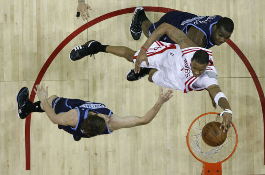 Rockets guard Tracy McGrady, center, scored a game-high 23 points and added 13 rebounds and nine assists in Game 2 of Houston's first-round playoff series with the Utah Jazz, but it wouldn't be enough to prevent the Rockets from losing 90-84 at Toyota Center. Houston fell to 0-2 in the series, which heads to Salt Lake City for Game 3. Photo: James Nielsen, Chronicle