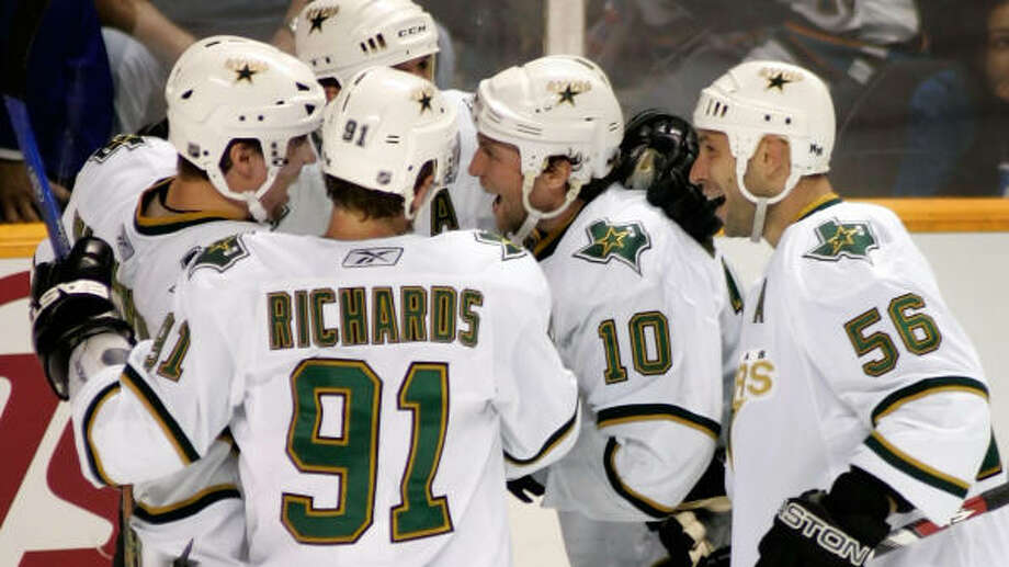The Stars' Niklas Hagman is congratulated by teammates after scoring a third period goal on Sunday. Photo: Christian Petersen, Getty Images