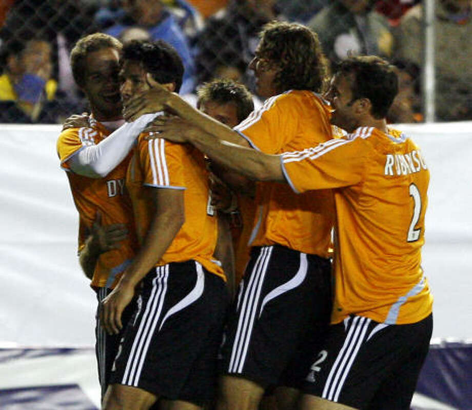A goal by Brian Ching, left, in the 80th minute had the Dynamo thinking their might be home free. But Pachuca scored two more times to win the series. Photo: Claudio Cruz, AP