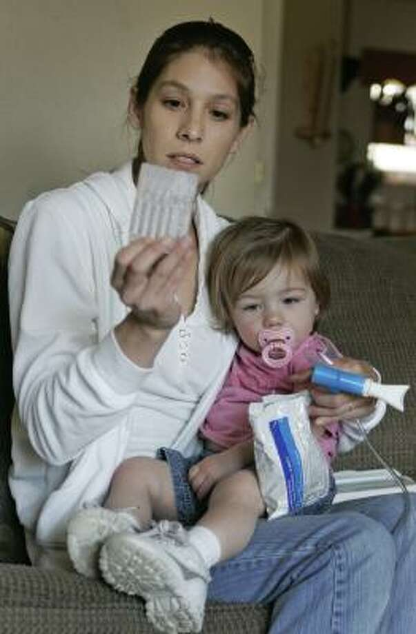 Gina Bouffanie was pregnant with Lexi, now 15 months and afflicted with asthma,when she lived in a FEMA trailer. Photo: BILL HABER, ASSOCIATED PRESS