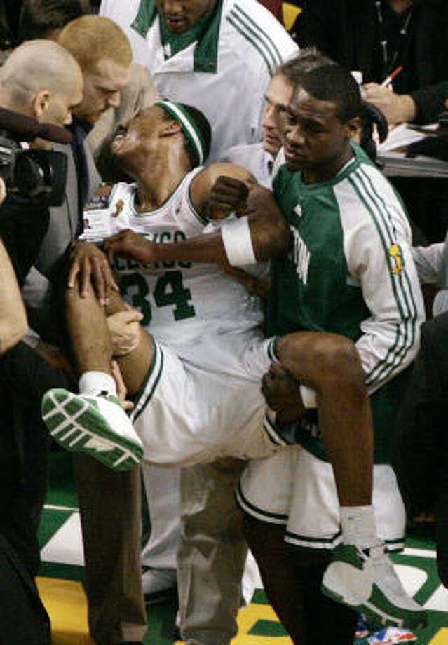 It wasn't as bad as it looked as Boston Celtics forward Paul Pierce was taken off the court. Photo: Charles Krupa, AP