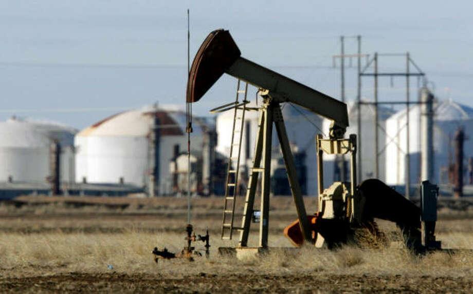 La economía de Houston, vinculada al petróleo, ha estado protegida de la crisis financiera, pero el descenso en los precios del crudo la haría vulnerable. Photo: Matt Slocum, AP