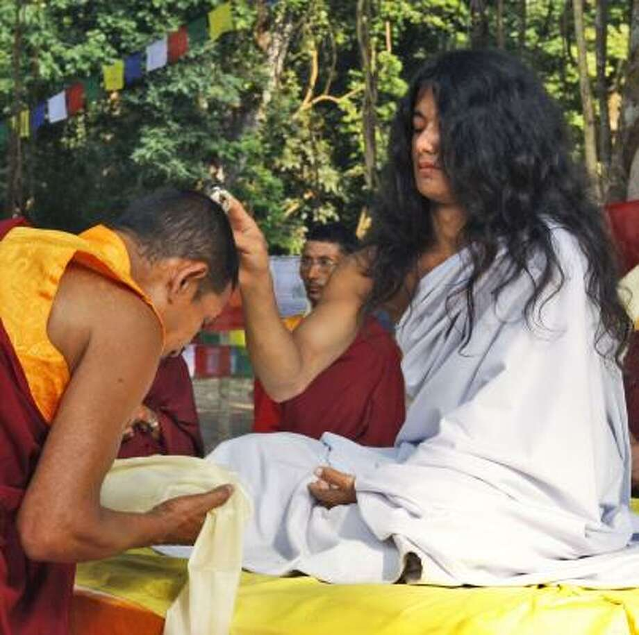 Ram Bahadur Bamjan blesses a Buddhist monk in the town of Nijgadh in Nepal. Photo: BINOD JOSHI, ASSOCIATED PRESS
