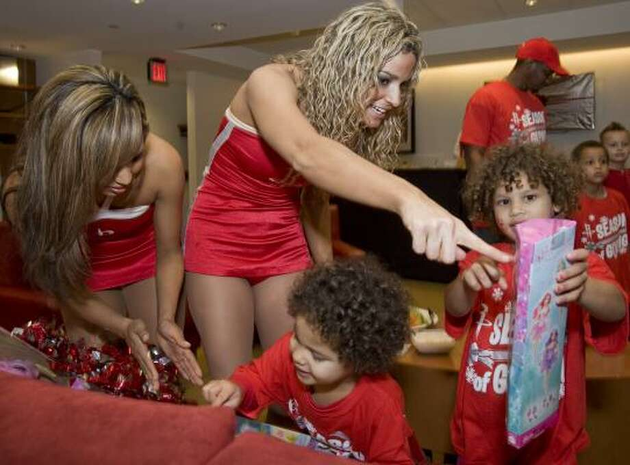 Rockets Power Dancers Natalie and Shelly join sisters Renee and Jayde Wesley at a party for Goodfellows children before the Rockets game Friday night. Photo: STEVE UECKERT, HOUSTON CHRONICLE