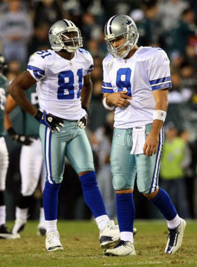 Terrell Owens, left, says everything is cool between him and quarterback Tony Romo, right. Photo: Jim McIsaac, Getty Images