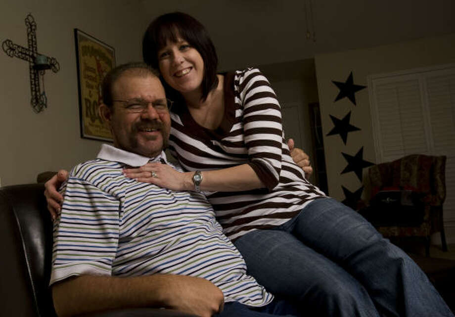 Newlyweds Mindy and Christopher Sledge at their College Station home, Jan. 27. Photo: Sharon Steinmann, Chronicle