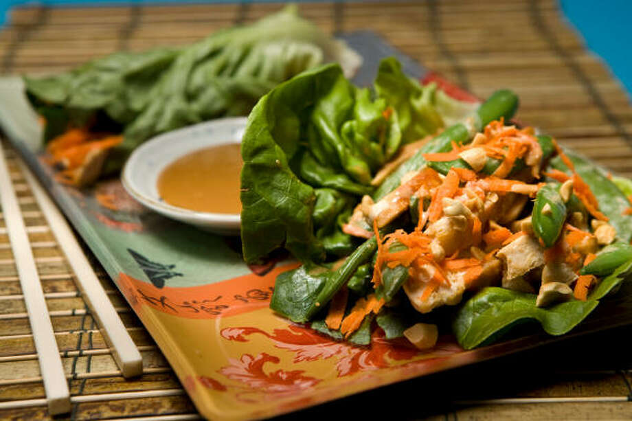 You won't feel like you're eating on the cheap with fanciful meals such as Asian Chicken Wraps With Steamed Snap Peas. Photo: Nick De La Torre, Chronicle