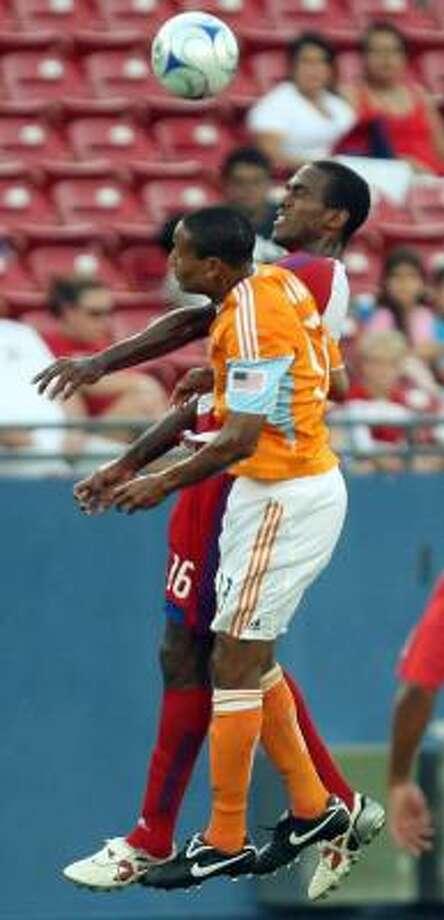FC Dallas' Atiba Harris (16) and the Dynamo's Ricardo Clark go up for a header during the first half of their match last week in Frisco. The Dynamo look to rebound tonight against the Chicago Fire. Photo: Vernon Bryant, AP