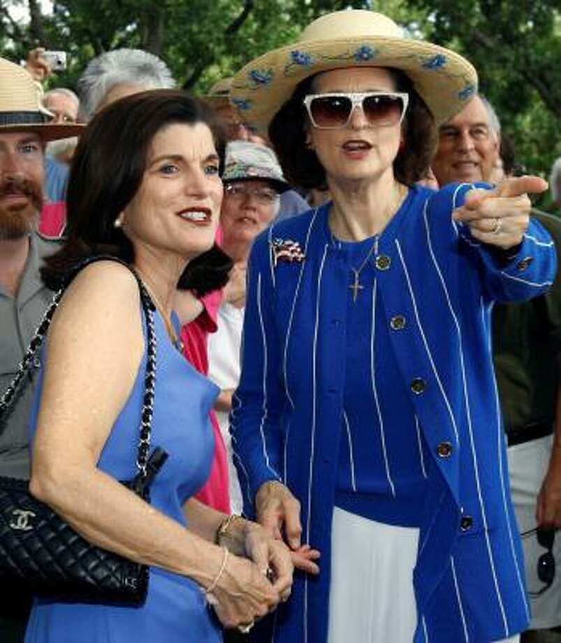 Luci Baines Johnson, left, and her sister, Lynda Johnson Robb, talk during 2008 ceremonies to commemorate the 100th birthday of their father, former President Lyndon Baines Johnson at the family cemetery on the LBJ Ranch near Stonewall, Texas. Photo: Harry Cabluck, AP