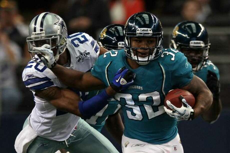 Jaguars running back Maurice Jones-Drew pushes away from Cowboys cornerback Alan Ball. Photo: Stephen Dunn, Getty Images