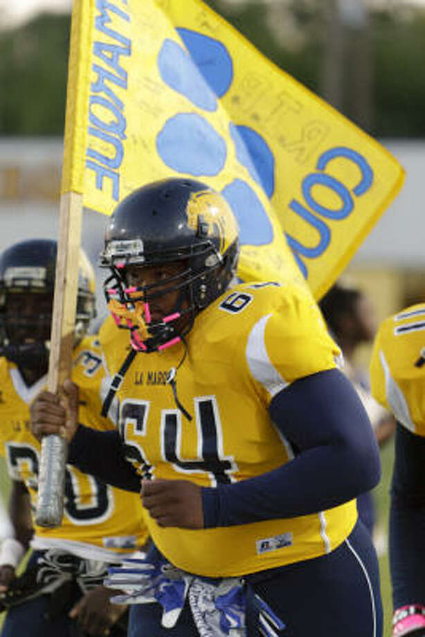 La Marque's Elijah Pleasant will carry the flag with him onto the field once more, in what will be another emotional moment. Photo: Bob Levey, For The Chronicle