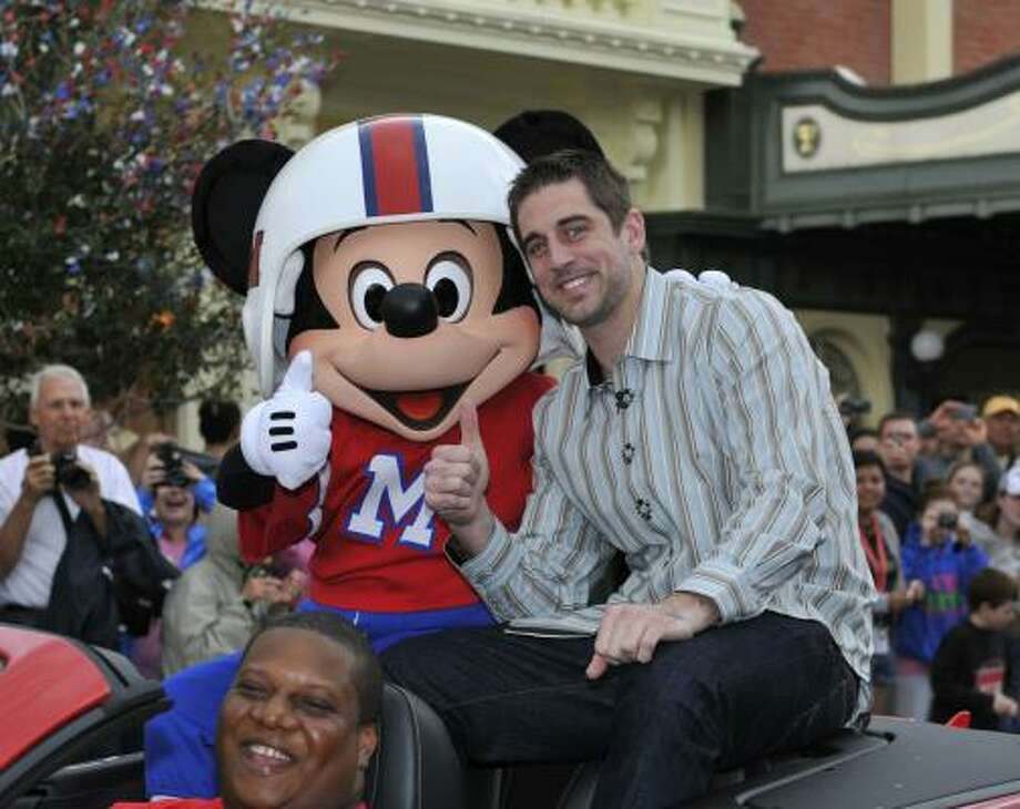 Super Bowl XLV MVP Aaron Rodgers takes a celebratory ride with Mickey Mouse, following the Green Bay Packers' 31-25 victory over the Pittsburgh Steelers at the Walt Disney World Resort in Lake Buena Vista, Florida on Monday. Photo: Handout, Getty Images