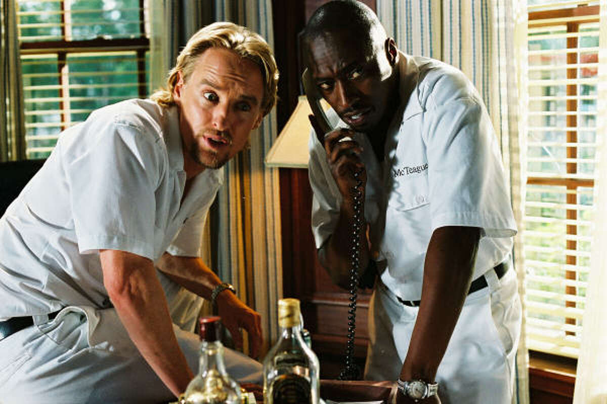 Owen Wilson, left, as Neil King and Eddie Griffin as McTeague.