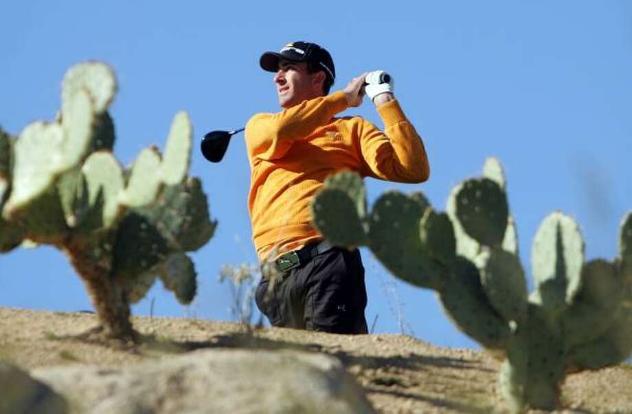 Framed by Arizona cacti, Geoff Ogilvy keeps his drive true on the 13th hole of the Accenture Match Play Championship. He'll play Henrik Stenson Sunday for the tournament title. Photo: ANDY LYONS, GETTY IMAGES