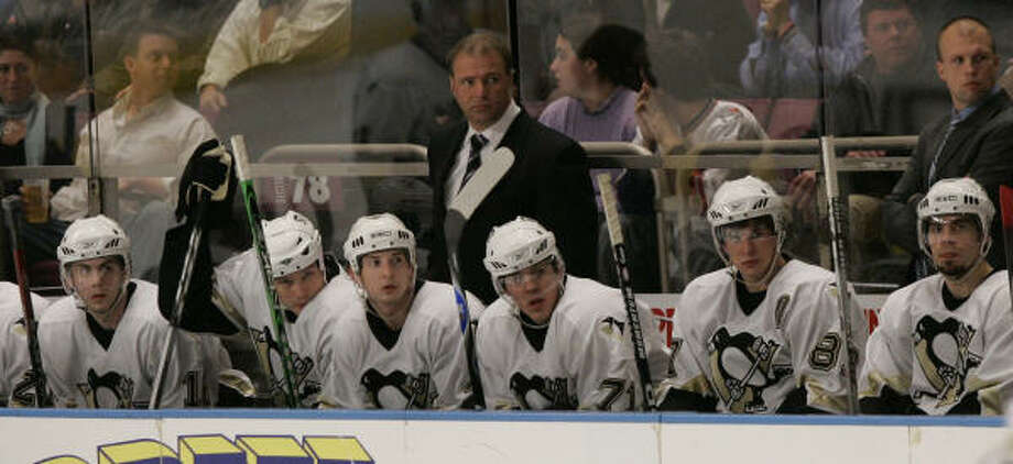It looks like Pittsburgh Penguins coach Michael Therrien, center, and his young team will either be playing in Kansas City next season or staying put in Pittsburgh, where a renewed effort is being launched by the state of Pennsylvania to keep the team in the Steel City. Photo: Mary Altaffer, AP