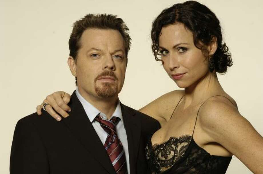In The Riches, Wayne Malloy (Eddie Izzard) is a con man and Dahlia Malloy (Minnie Driver) is the family matriarch who is about to be released from prison. Photo: FX