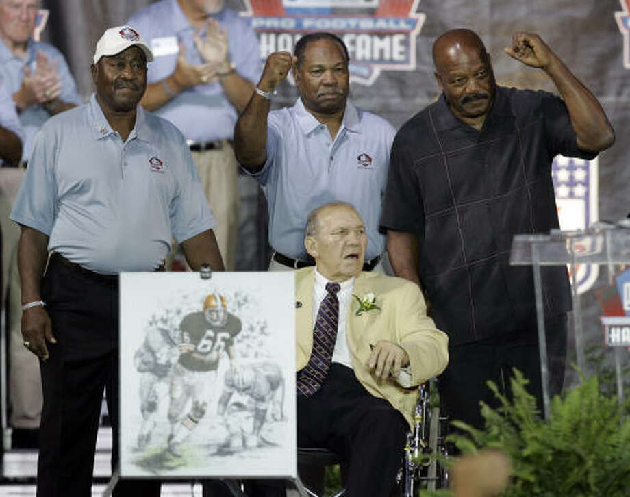 Hall of Famers and former Browns from left Leroy Kelley, Bobby Mitchell and Jim Brown, stand behind Gene Hickerson. Photo: Tony Dejak, AP