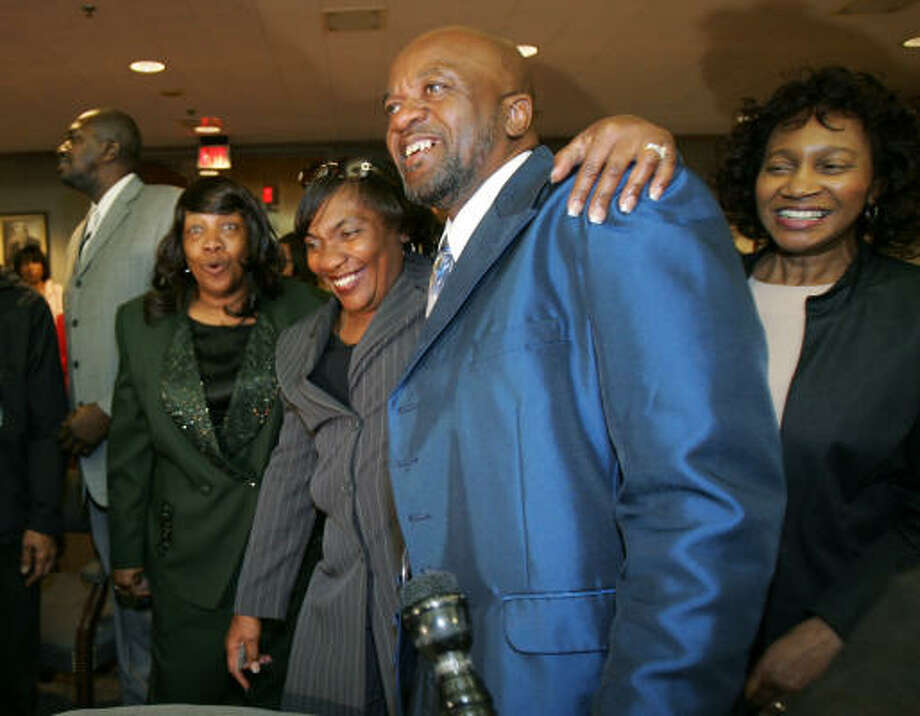 James Curtis Giles and his family celebrate Monday after Giles joined a growing list of men in Dallas County exonerated by DNA evidence since 2001. Photo: Tim Sharp, AP
