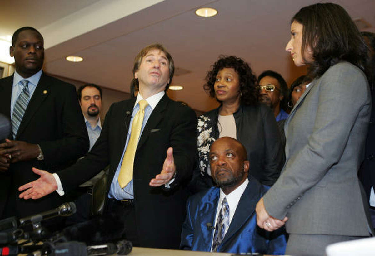 Innocence Project Co-Director Barry Scheck, center standing, and James Curtis Giles are pushing for a commission that would investigate the causes of wrongful convictions.