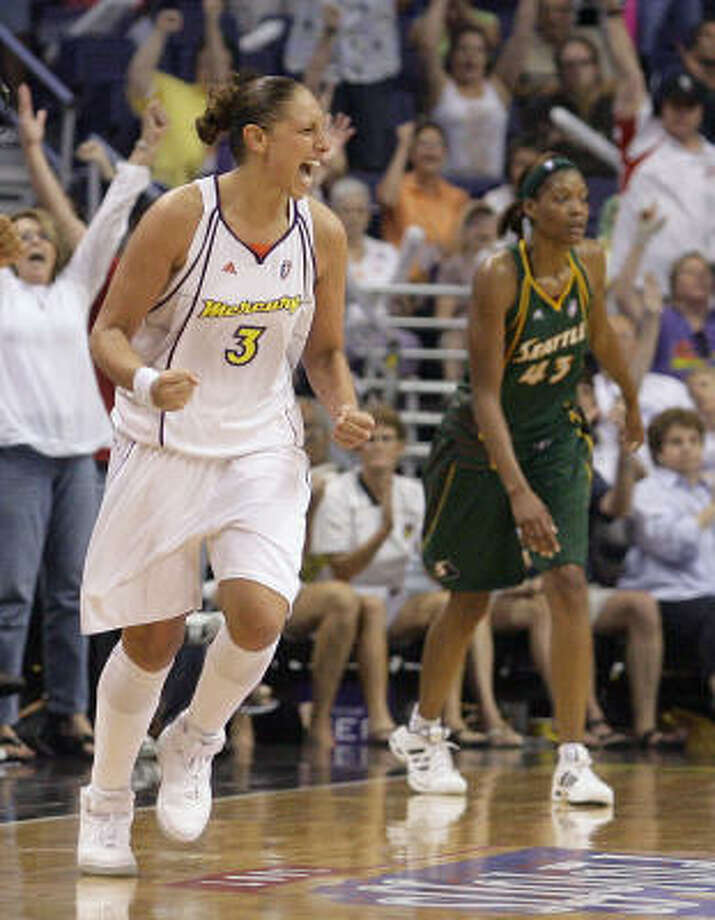 Mercury guard Diana Taurasi, left, helped put away the Storm with a tie-breaking 3-pointer in the fourth quarter. Photo: Paul Connors, AP