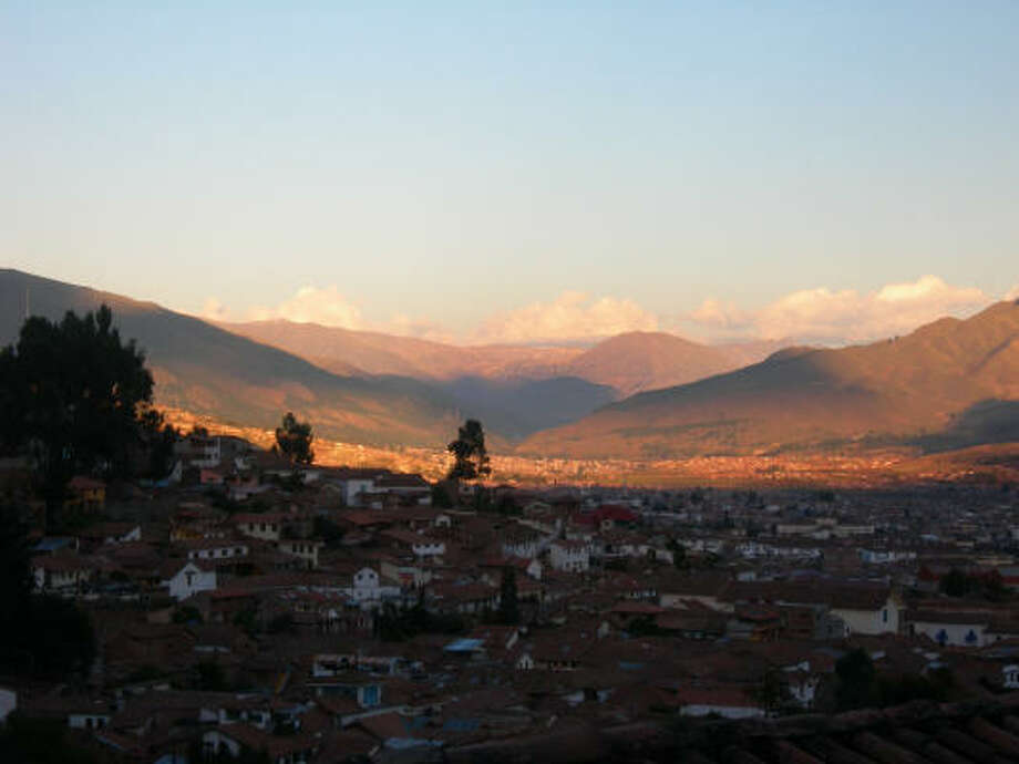 The sun sets over Cuzco, Peru, as seen from Sacsayhuaman, the Inca ruins just north of the city. Photo: Eileen McClelland, For The Chronicle