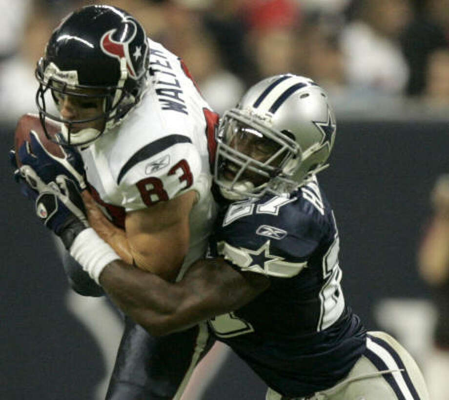 Kevin Walter, the next receiver after Andre Johnson on the depth chart, has just two catches in the regular season. This one came against the Ken Hamlin and the Cowboys in the preseason. Photo: Brett Coomer, Chronicle