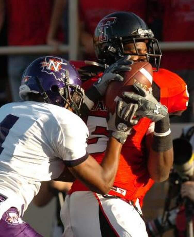 Texas Tech receiver Michael Crabtree, right, hauls in a touchdown pass from Graham Harrell, one of three the duo connected for during a 75-7 win over Northwestern State. Photo: Joe Don Buckner, AP