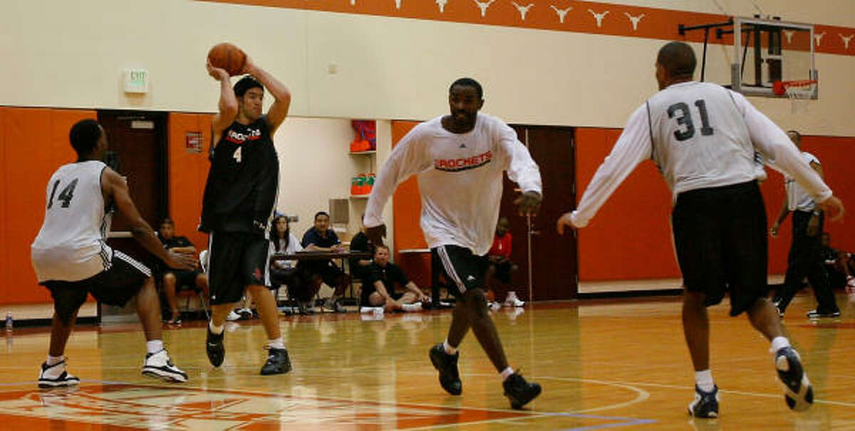 Rockets forward Luis Scola (4) looks to pass during the third day of training camp on Thursday.