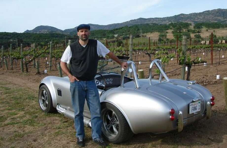 Winemaker Gerry Rowland stands in Napa Valley's Bluetooth Vineyard alongside the Shelby Cobra he built. Photo: LINDA ROWLAND