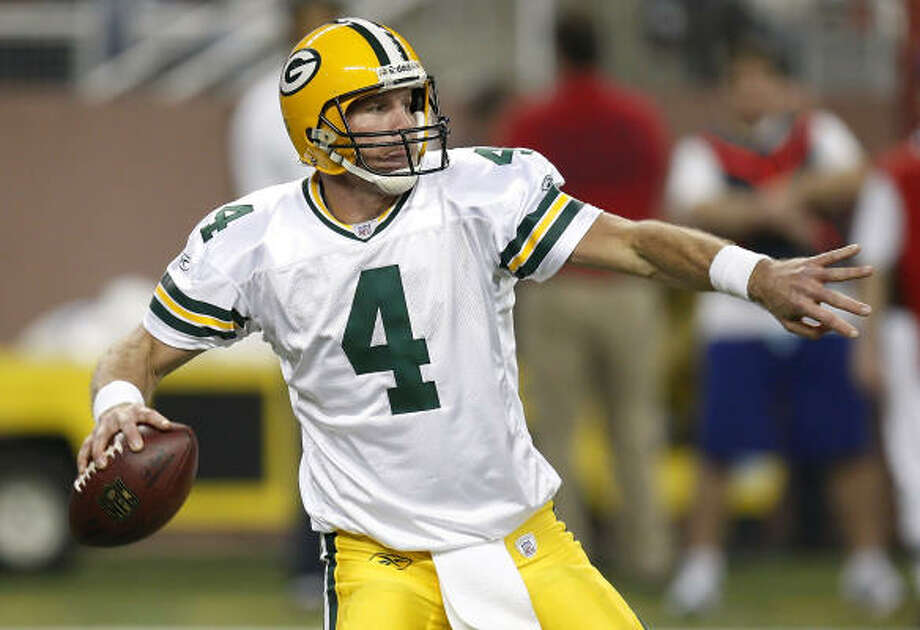Packers quarterback Brett Favre threw at least three touchdowns for the second consecutive game and 63rd time in his career, passing the mark set by Dan Marino. Photo: Gregory Shamus, Getty Images