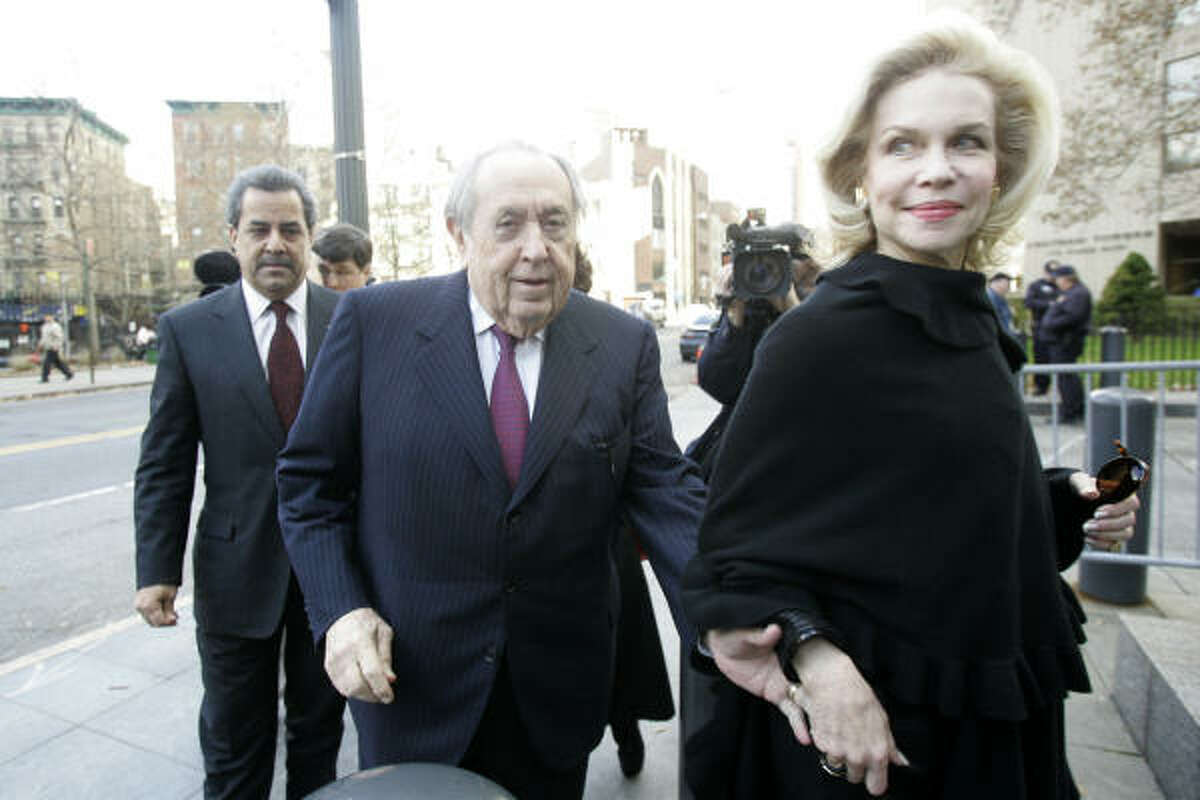 Oscar S. Wyatt Jr., 83, founder and former chairman of Coastal Corp., arrives at Manhattan federal court with his wife, Lynn, to be sentenced for his part in a United Nations oil-for-food corruption case Tuesday in New York.